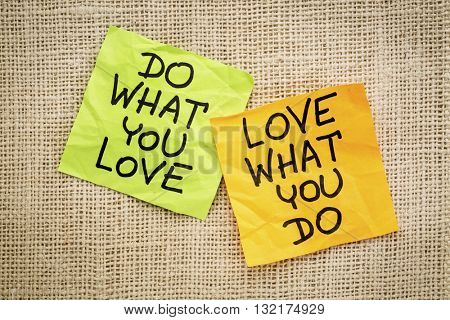 do what you love, love what you do - motivational word advice or reminder  on sticky notes against canvas