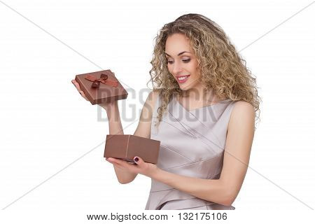 Present. woman in coctail dress opening gift