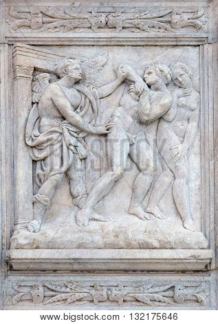 BOLOGNA, ITALY - JUNE 04: Expulsion from Paradise, Genesis relief on portal of Saint Petronius Basilica in Bologna, Italy, on June 04, 2015