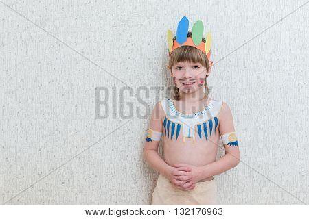 Blond Boy Playing Injun