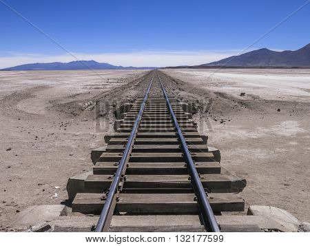 Railroad crossing a deset in the south of Bolivia