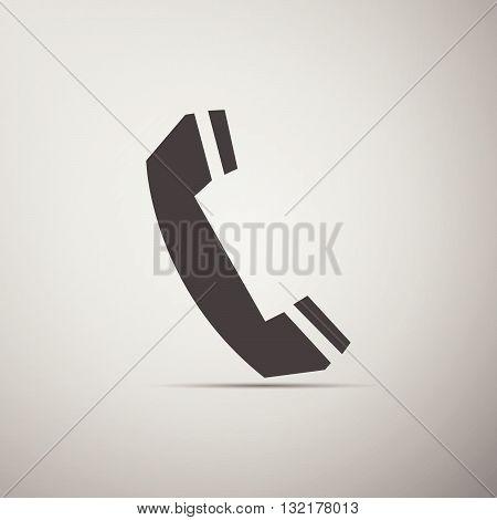 Telephone handset icon on gray background. Vector Illustration.