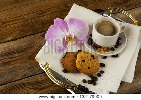 Romantic coffee served with orchid on the serving tray. Coffee cup. Cup of coffee. Strong coffee. Coffee mug. Morning coffee. Coffee break.
