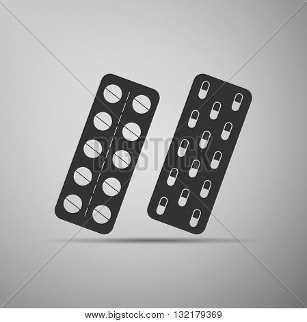 Pills in a blister pack icon on gray background. Vector illustration