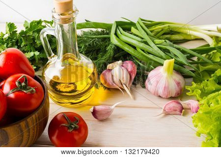 Fresh summer vegetables and olive oil. Ripe vegetables. Fresh vegetables. Healthy eating concept. Vegetarian food. Healthy eating.