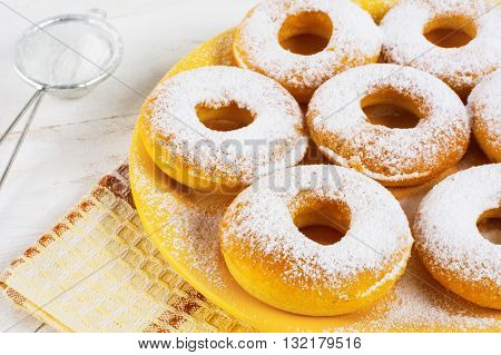 Homemade donuts with caster sugar. Doughnuts. Sweet pastry. Donuts. Sweet dessert.
