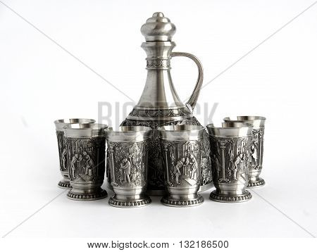 Vintage pewter decanter and glasses isolated on a white background