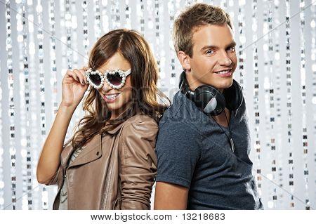 Stylish couple dancing in the nightclub