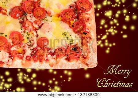 pizza margherita made with mozzarella and cherry tomatoes on red background with glitter and merry christmas written