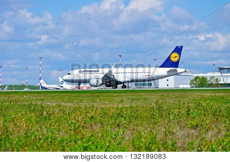 SAINT PETERSBURG RUSSIA - MAY 11 2016. D-AIUK Lufthansa Airbus A320 airplane rides on the runway after arrival at Pulkovo airport