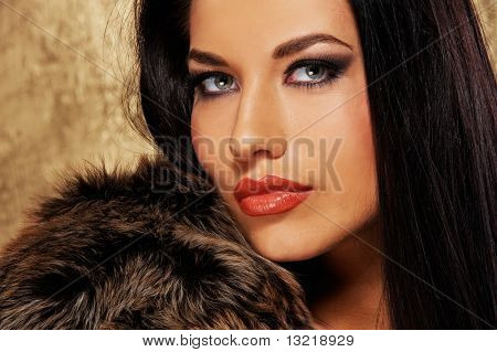 Close-up portrait of an attractive brunette woman