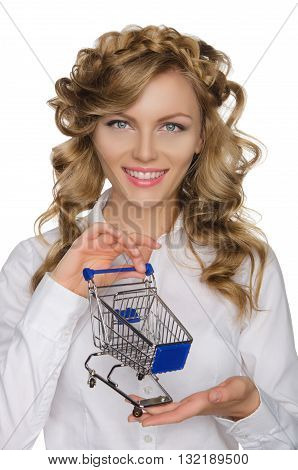 young woman with trolley for shopping isolated on white