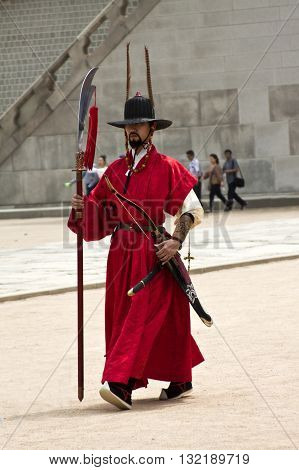 Seoul, Korea - May 17 2015: Armed guards in traditional costume guard the gate at Gyeongbokgung Palace a tourist landmark in Seoul, South Korea on May 17 2015