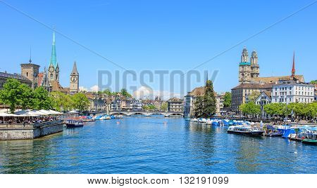 Zurich, Switzerland - 26 May, 2016: view along the Limmat river from the Quaibruecke bridge towards the Muensterbruecke bridge. Zurich is the largest city in Switzerland and the capital of the Swiss canton of Zurich.