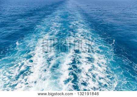 Wake on the blue sea water surface