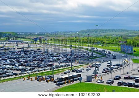 ST PETERSBURG RUSSIA - MAY 11 2016. Birds eye view of airport auto crowded parking lot in Pulkovo International airport in Saint-Petersburg Russia