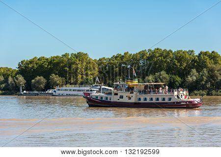 Cruise Boat On Garonne River In Bordeaux, France