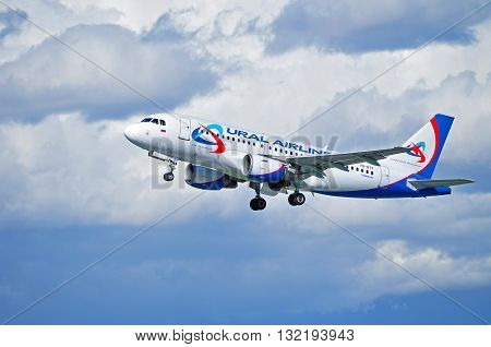 ST PETERSBURG RUSSIA - MAY 11 2016. VQ-BTY Ural Airlines Airbus A319 airplane is flying in the sky after departure from Pulkovo International airport