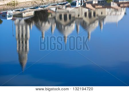 Defocused Water reflections View of Saint Front Cathedral in Perigord France