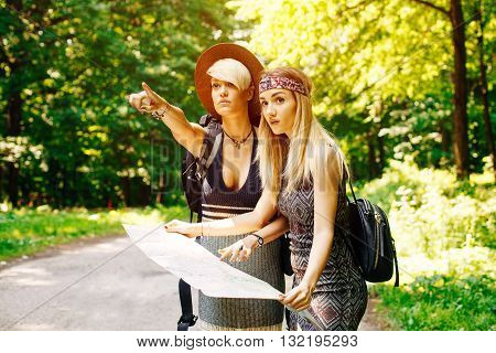 Two women lost in the woods trying to find direction