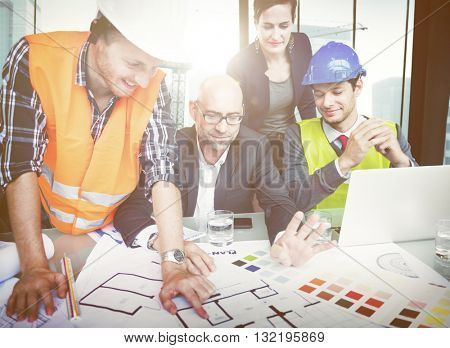 Business People and Architects in a Meeting
