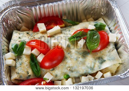 Healthy eating, diet concept. Healthy lunch, Take away organic food. Weight loss diet, food take away in aluminium box. Healthy food background. Vegetables and french crepe with cheese at white wood
