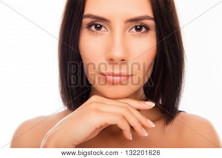 Close up portrait of calm brunette touching her chin