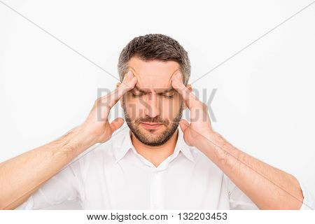 Young Sad Businessman With Big Problems Touching His Head