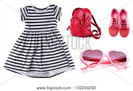 Set of little girl clothes isolated on white