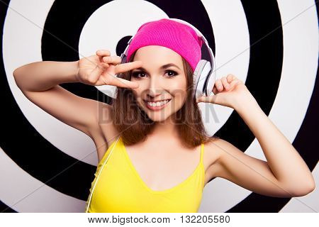 Portrait Of Music Lover Listening Music And Gesturing With Two Fingers