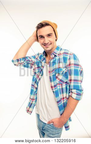 Handsome cheerful young man in hat  on a white background