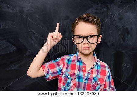 Portrait Of Little Genious In Glasses Having Great Idea
