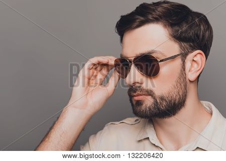 Portrait Of Handsome Brutal Bearded Man Touching His Spectacles