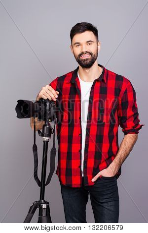 Young Photographer Preparing For Taking Pictures With Digital Camera