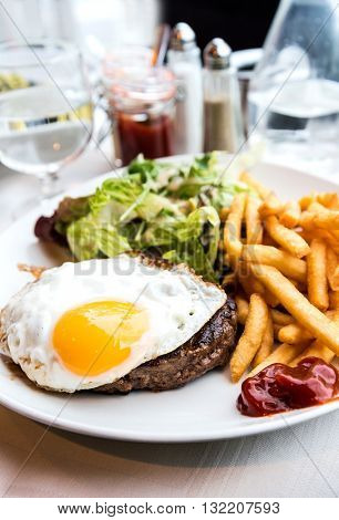 Egg and fries - classical english breakfast with egg and fries