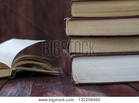 stack of old book on a wooden shelf