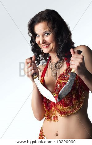 Insane woman with knife smile