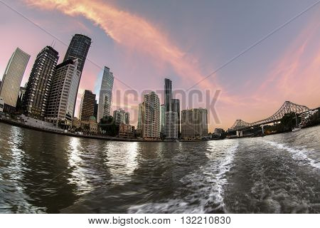 BRISBANE, AUSTRALIA - MAY 25 2016: Fisheye view sunset over Brisbane citycape and Story Bridge, view from the river ferry