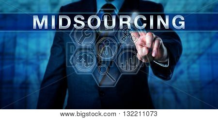 High tech engineer is touching MIDSOURCING on a virtual interactive control display. Business metaphor and information technology concept for contracting a local engineering service provider.