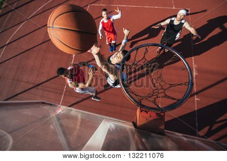 High angle shot of a basketball player scoring a point.