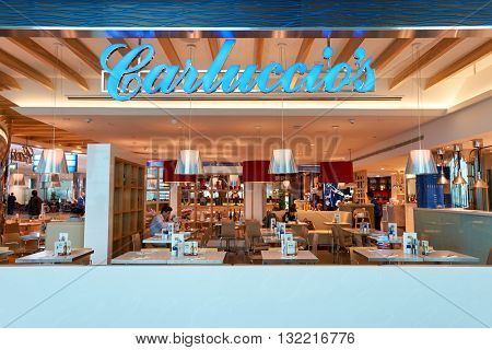 DUBAI, UAE - MARCH 09, 2016: inside of Dubai International Airport. There are a lot of restaurants, bars, cafes and shops in Dubai International Airport. Almost all of them are open twenty-four hours.