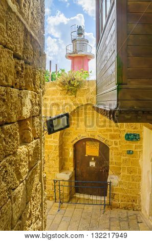 Alley And A Lighthouse In The Old City Of Jaffa
