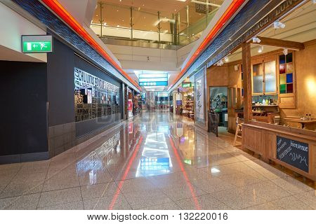 DUBAI, UAE - APRIL 08, 2016: inside of Dubai International Airport. There are a lot of restaurants, bars, cafes and shops in Dubai International Airport. Almost all of them are open twenty-four hours.