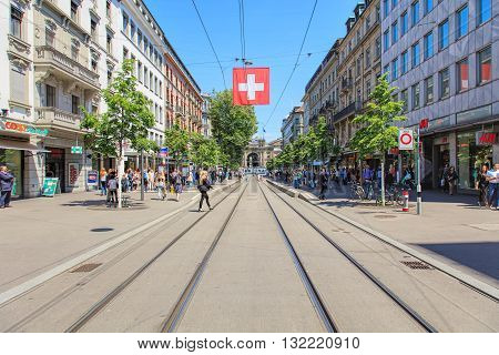 Zurich, Switzerland - 26 May, 2016: view along Bahnhofstrasse street towards Zurich main train station. Zurich is the largest city in Switzerland, Bahnhofstrasse is Zurich's main downtown street and one of the world's most expensive shopping avenues.