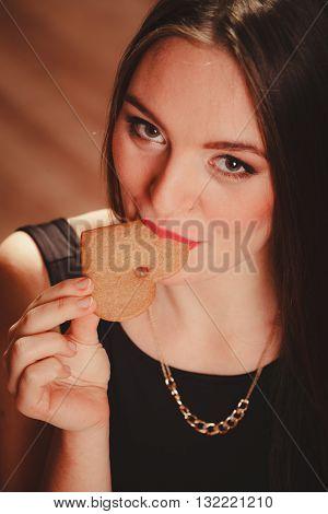 Woman Tasting Heart Cake