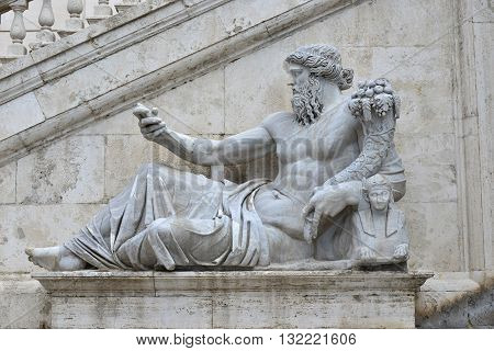 Ancient marble statue of River Nile god with sphinx from Capitoline Hill Square in the center of Rome