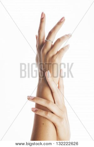 beauty delicate hands with manicure close up isolated on white perfect shape, french nails
