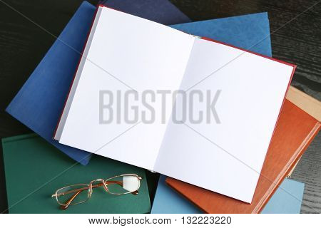 Open book and glasses  on table