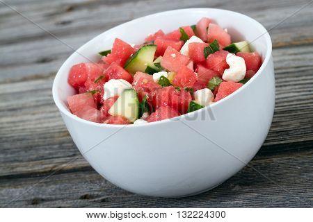 melon feta mint and cucumber healthy summer salad bowl closeup