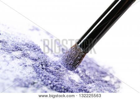 Makeup brush with cosmetic powder isolated on white
